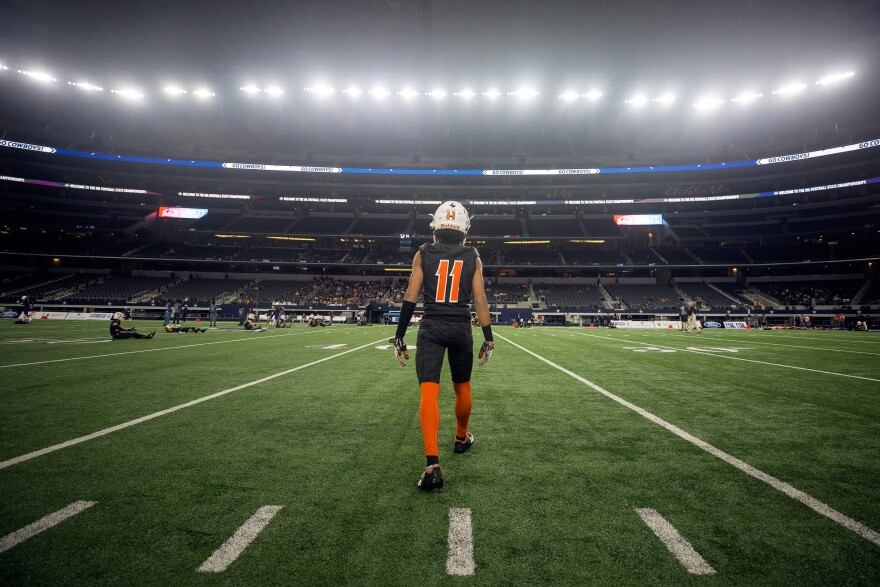 Refugio's Tyreke Jones walks onto the field before the start of the state championship game against the Mart Panthers on Wednesday.