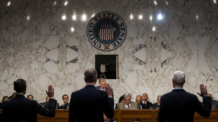 Richard Salgado (from left), director of law enforcement and information security at Google; Sean Edgett, acting general counsel at Twitter; and Colin Stretch, general counsel at Facebook, are sworn in during a Senate Judiciary Subcommittee on Crime and Terrorism hearing on Oct. 31.