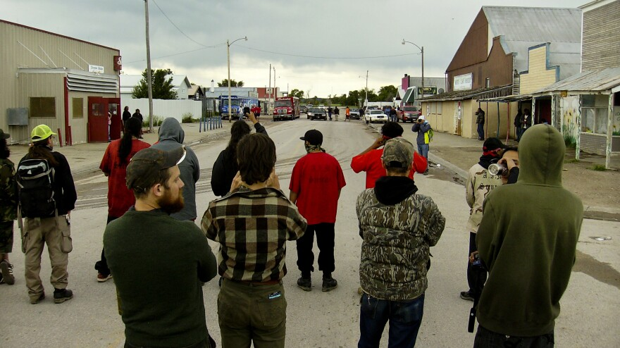 Protests against alcohol deliveries are a recurring event in Whiteclay. Authorities have accused the protesters of vandalizing beer trucks, while activists say a liquor store owner has hired people to intimidate them.