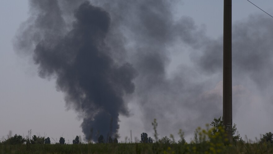 Black smoke rises from the spot where a Ukrainian army helicopter was shot down outside Slovyansk, Ukraine, on Thursday. Rebels shot the craft down amid heavy fighting around the eastern city.