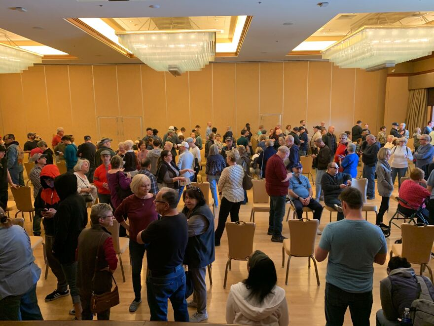 Voters waited more than two hours in a line that snaked through a ballroom at Sun City Anthem in Henderson, Nev., on Monday. It was one of many early caucus sites where voters faced long lines.