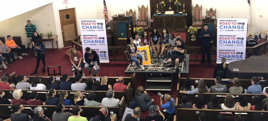 More than a hundred people filled the pews at La Trinidad United Methodist Church for a panel discussion on gun control July 9. Others sat in an overflow room.