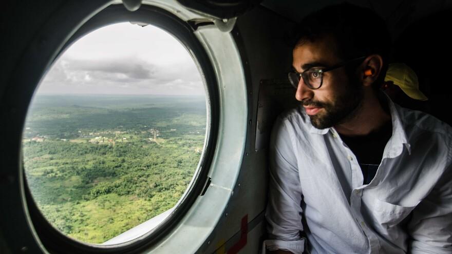 Sami Yenigun flies into Lofa province in a U.N. helicopter.