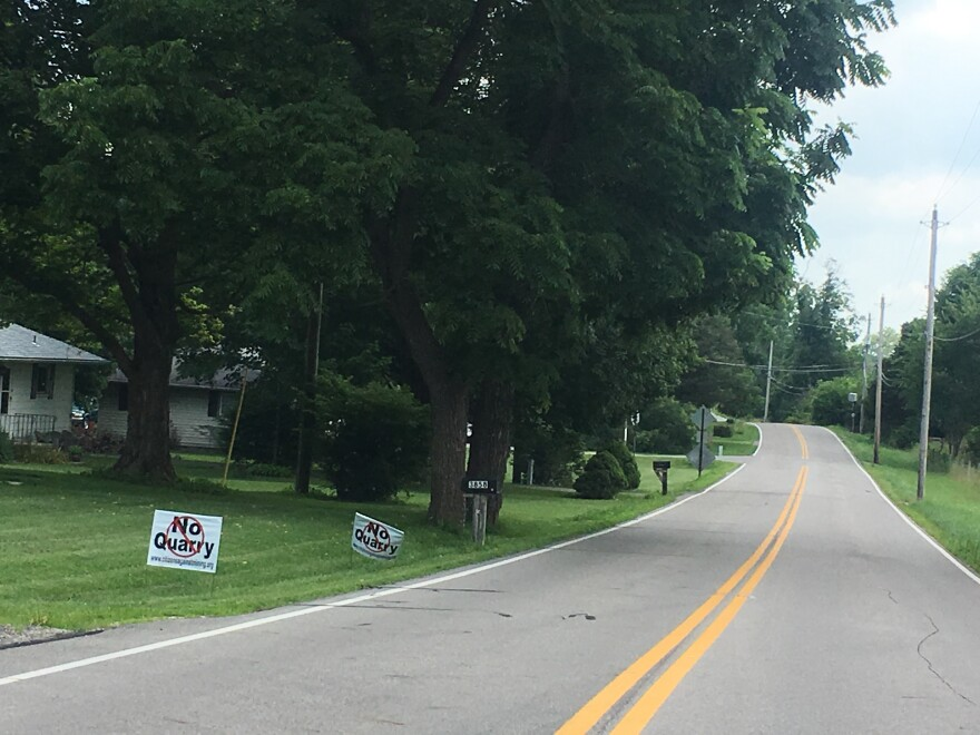 """""""No Quarry"""" signs courtesy of Citizens Against Mining line a road in Mad River Township."""
