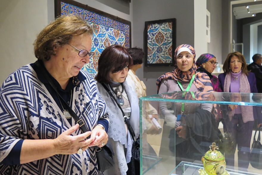 Shahinda Karim (left), a professor of Islamic Art at the American University in Cairo, leads a tour through the newly restored galleries.