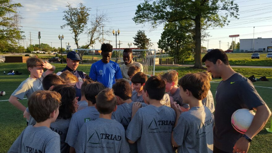 Saadiq Mohhamed and Sa'ad Hussein are two Somali soccer stars that have started a new life in St. Louis after leaving their war-torn home. They are pictured here working with children at a St. Louis soccer park.