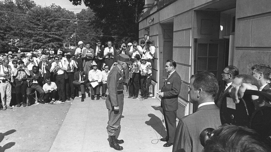 Alabama Gov. George Wallace (right) blocks the door of the the Foster Auditorium at the University of Alabama in Tuscaloosa, Ala., on June 11, 1963. Wallace, who had vowed to prevent integration of the campus, gave way to federal troops.