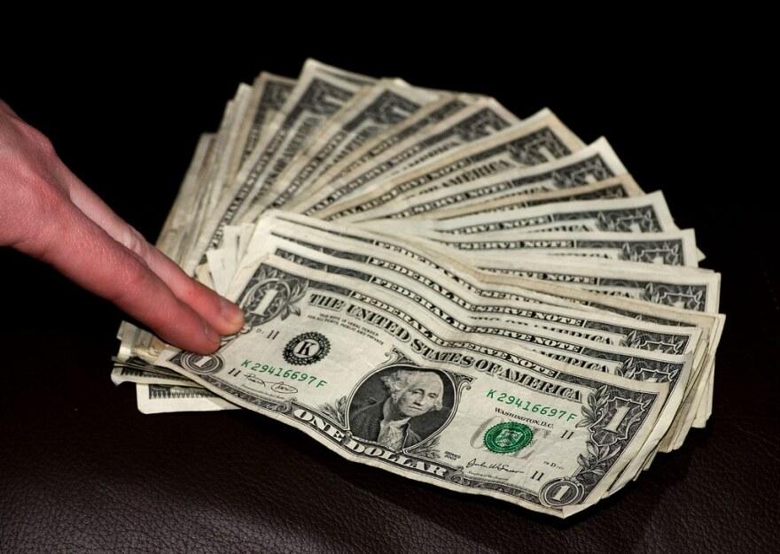 a photo of one dollar bills