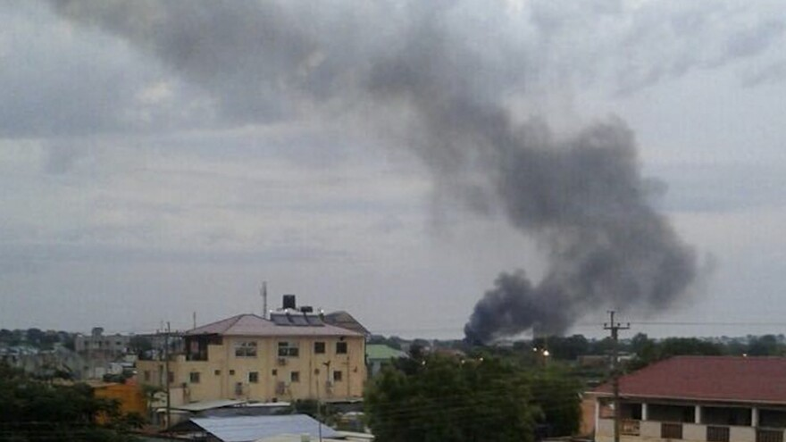 Black smoke rises above Juba, the capital of South Sudan, on Sunday. Explosions and heavy weapons gunfire are shaking Juba Monday in the fifth day of clashes between government and opposition forces, raising the specter of a return to civil war.