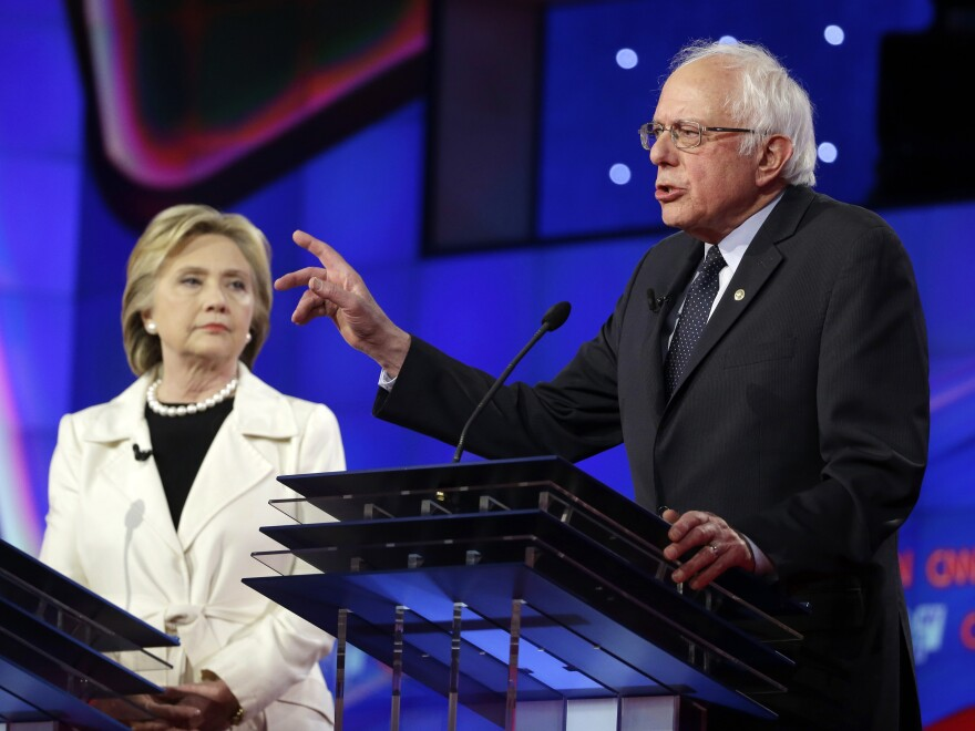 Sen. Bernie Sanders, I-V.t, right, speaks as Hillary Clinton looks on during an April Democratic debate in New York.