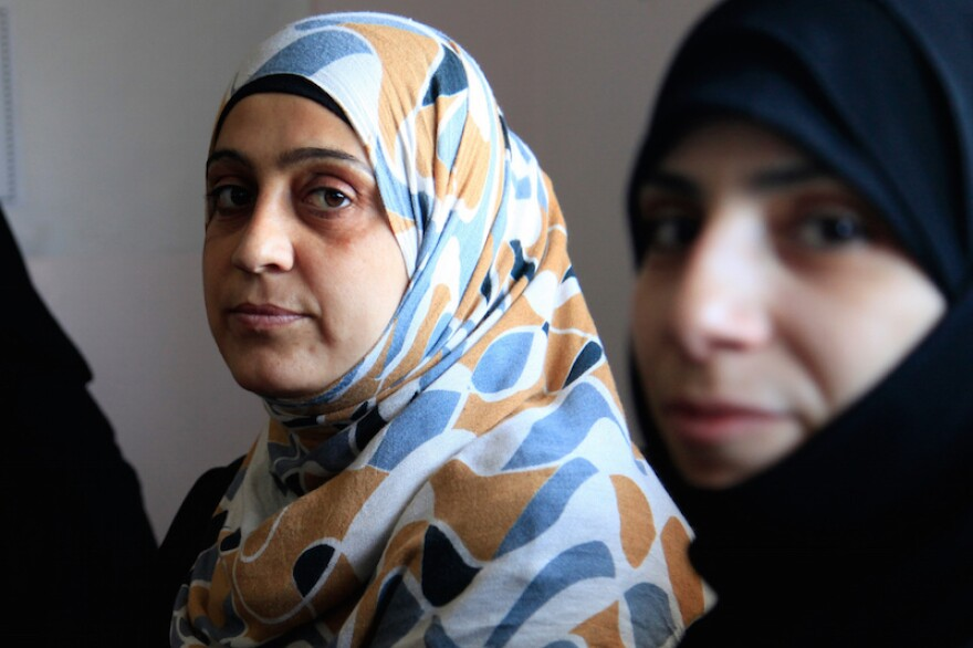 Texas groups that resettle Syrian refugees, like these women, could be sued by the state.