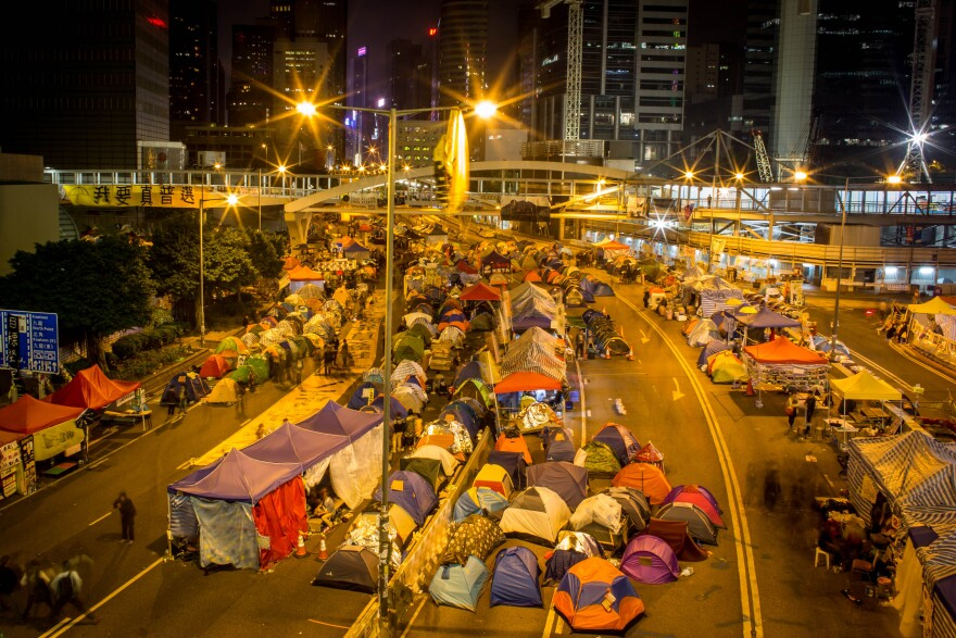 Pro-democracy activists tents are seen Tuesday on the road outside Hong Kong's Government Complex.