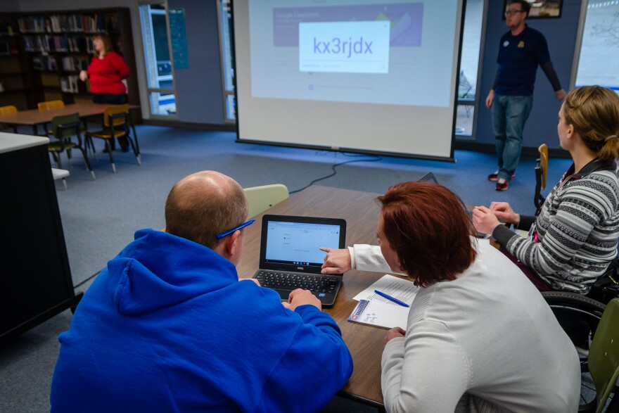 Cross Keys Middle School teachers Richard Kling and Heather Linblad try to figure out how to log into Google Classroom during a training Monday as the Ferguson-Florissant and most other regional school districts plan to close to in-person classes for thre