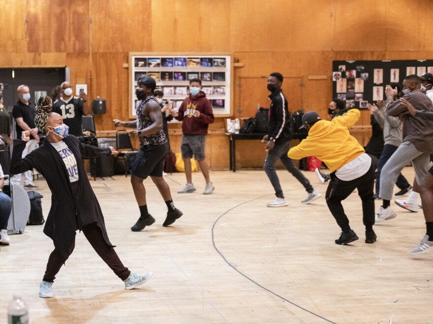 Co-director and choreographer Camille A. Brown (left) leads members of the ensemble of <em>Fire Shut Up in My Bones</em> in a movement workshop.