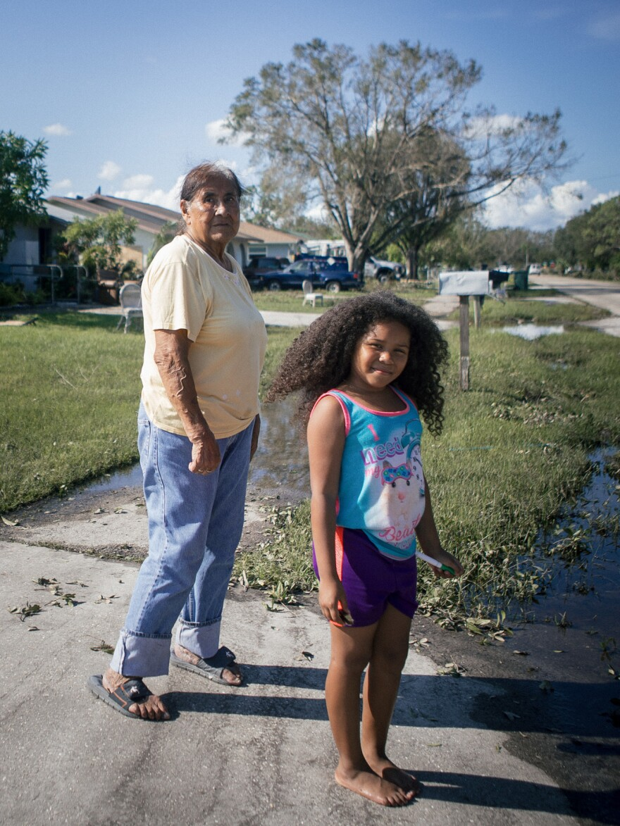 Sixta Vidaurri and her granddaughter Amree Vidaurri stand outside their home. They couldn't cook without power and many of the grocery stores in town were still shuttered, two days after the storm.
