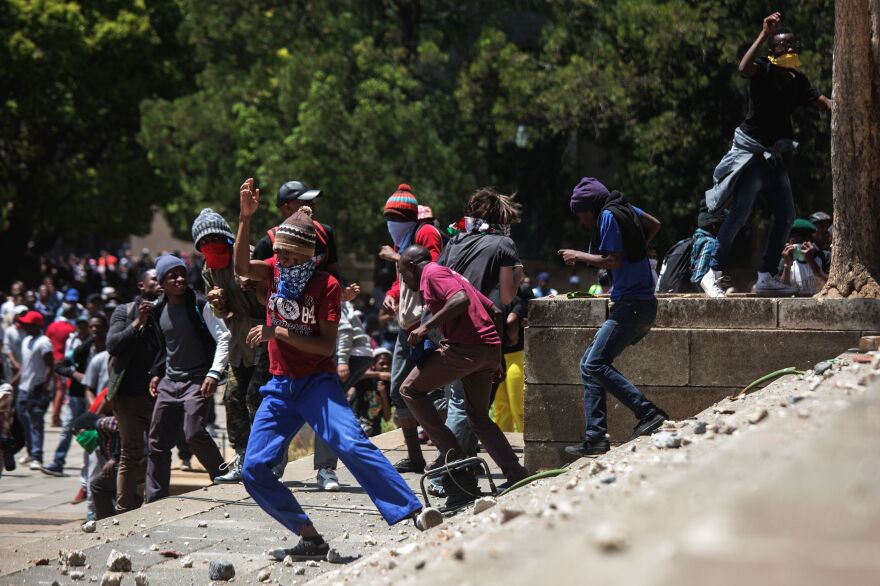 Amid growing tension over tuition fees, violent clashes with police have erupted regularly on campuses across South Africa in recent months, and several universities have been closed to avoid further unrest. At Wits University on Monday, protesters throwing rocks were dispersed by riot police using tear gas, rubber bullets and stun grenades.