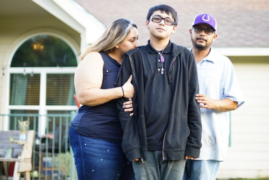 Xavier Castro outside his home with his parents in Dayton. After switching school districts, the family struggled to get Xavier the help he needed to succeed in school.