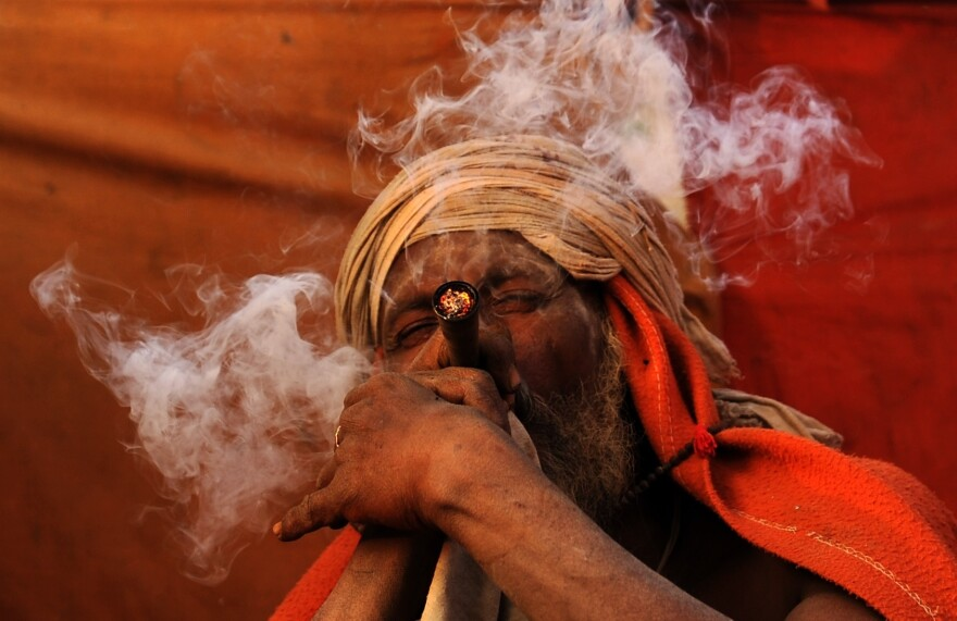 A Hindu holy man in Kathmandu smokes a chillum, a traditional clay pipe, on March 6, the eve of a festival honoring the god Shiva.