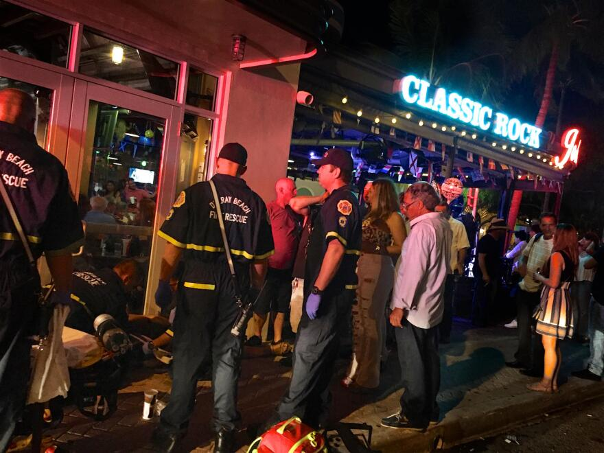 Delray Beach Fire Rescue firefighter-paramedics help a woman experiencing a dizzy spell in downtown Delray Beach on May 19, 2017. The emergency professionals must be ready to respond in any South Florida environment.
