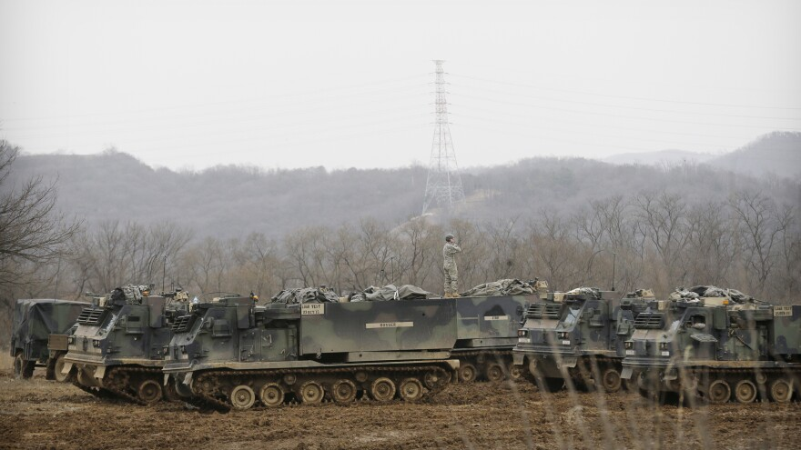 """A U.S. soldier stands on an armored vehicle during an annual exercise Monday in Yeoncheon, South Korea, near the border with North Korea. Pyongyang threatened a """"preemptive nuclear strike of justice"""" in retaliation for the joint training exercises."""