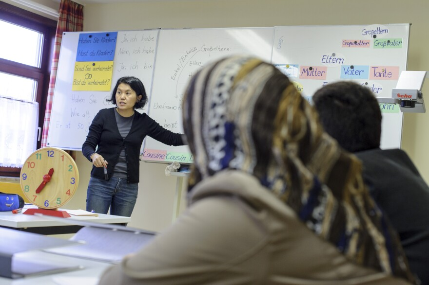 Syrian refugees participate in a German language class at the refugee center in Friedland, Germany, on Dec. 10. There are about 500 refugees at the camp, most of them Syrians.