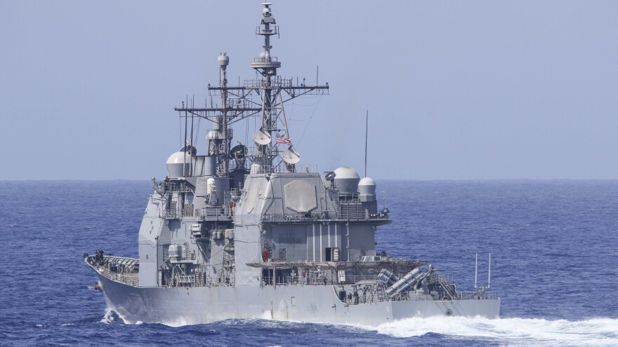 """The Ticonderoga-class guided-missile cruiser USS Chancellorsville was forced to """"execute all engines back full"""" and move out of the way of a Russian destroyer in the Philippine Sea, the U.S. Navy says. The Chancellorsville is seen here during a training exercise in the Pacific Ocean."""