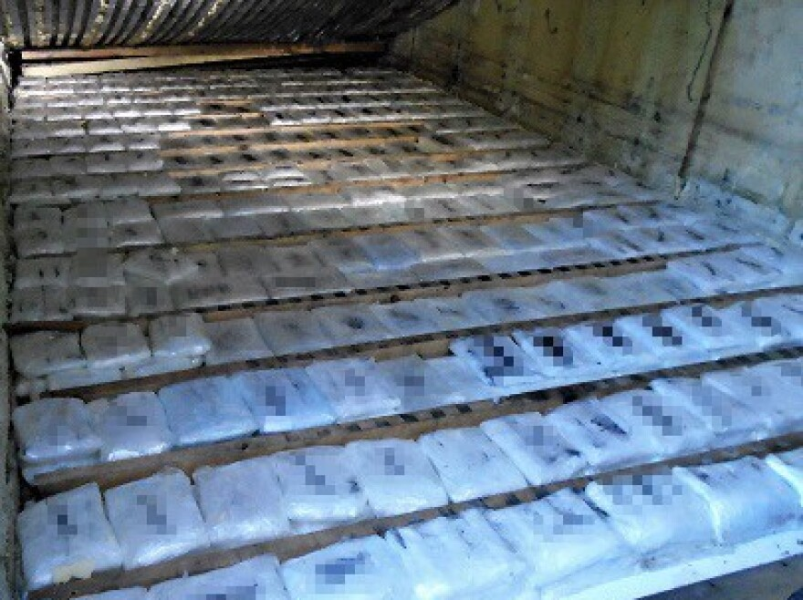 The drugs were allegedly hidden under a false door in a produce-hauling truck.