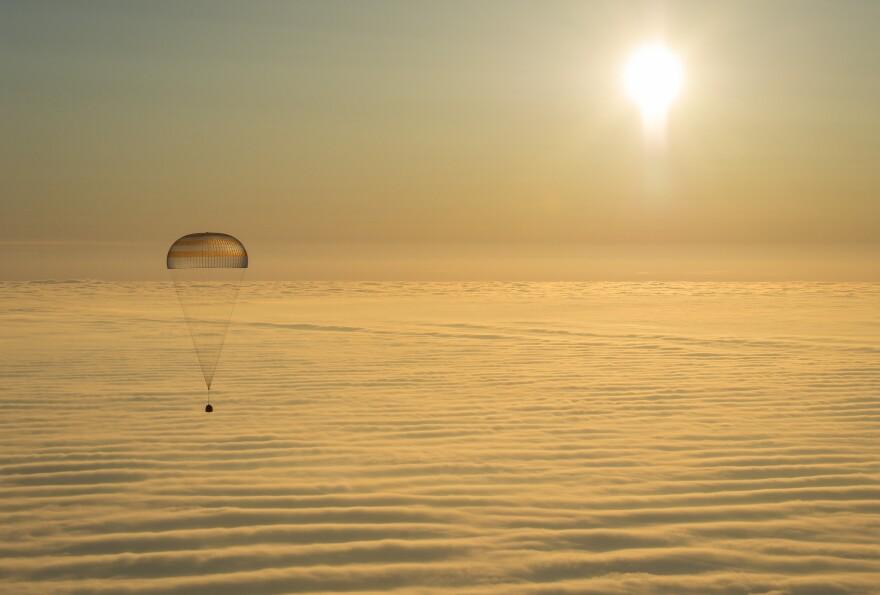 The Soyuz TMA-14M spacecraft is seen as it descends toward Earth, carrying NASA's Barry Wilmore and Russian flight engineers Alexander Samokutyaev and Elena Serova.