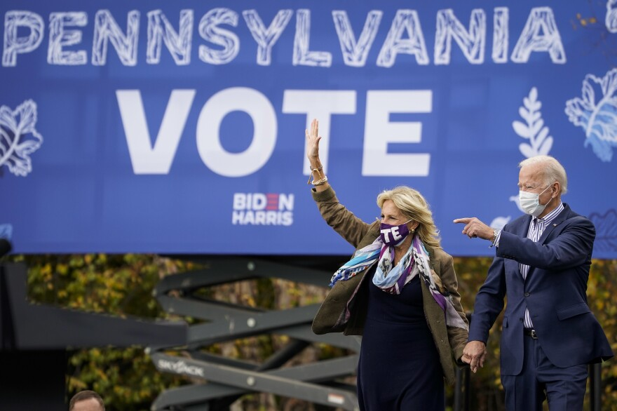 Joe Biden and his wife Jill Biden arrive for a drive-in campaign rally at Bucks County Community College on Oct. 24 in Bristol, Pa. Bucks County and three other suburban Philadelphia counties helped the president-elect win the swing state.