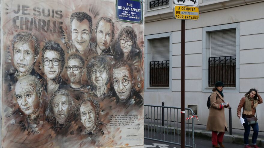"The work of French street artist Christian Guemy aka ""C215"" depicting members of satirical magazine <em>Charlie Hebdo</em> is painted on a facade near the magazine's offices at Rue Nicolas Appert in Paris, to commemorate the fifth anniversary of the attack of the magazine that killed 12 people."