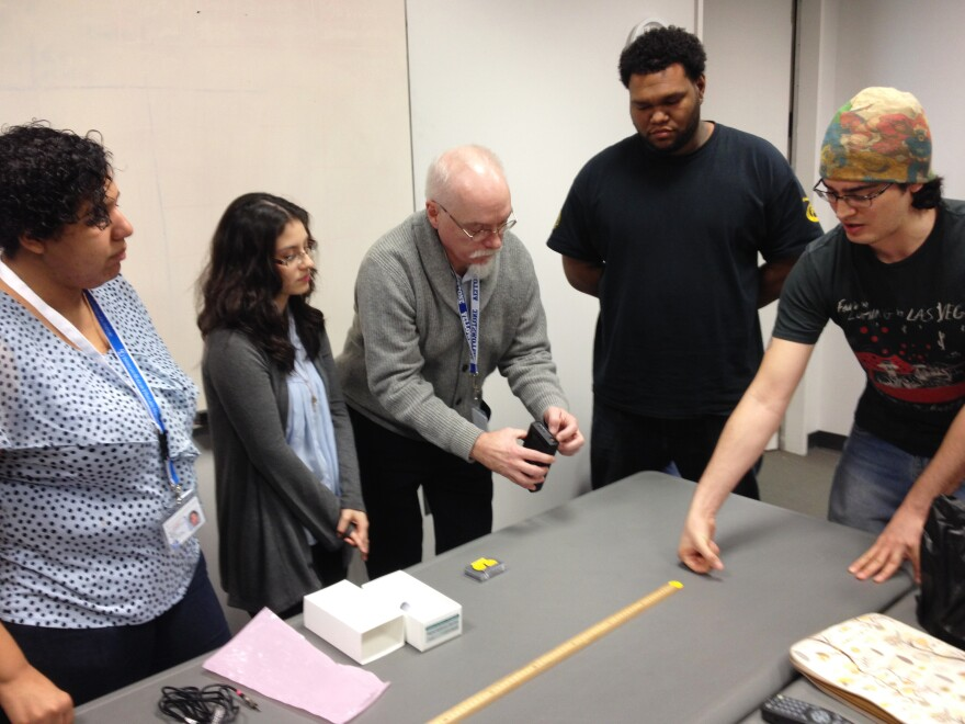 Students from CUNY's AstroCom NYC program meet for a weekly class at the American Museum of Natural History in New York City. Dennis Robbins, an associate professor of science education at CUNY's Hunter College, teaches Betsy Hernandez (from left), Jaquelin Erazo, Ariel Diaz and Mario Martin.