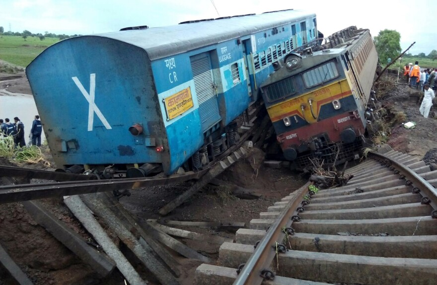Two passenger trains lay next to each other in India after they derailed Tuesday night. The accident is being blamed on flash floods outside the town of Harda in Madhya Pradesh state.