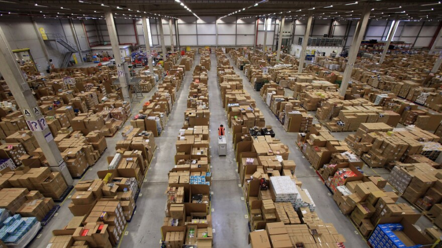 Workers process orders at an Amazon.com fulfillment center in Swansea, Wales, as they prepare for their busiest time of the year.