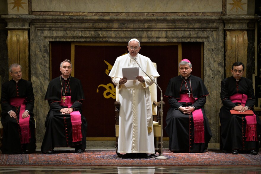 "Pope Francis delivers his message during a meeting with cardinals and bishops of the Curia at the Vatican on Monday. The pope said the Curia suffered from ""spiritual Alzheimer's""  and careerism."
