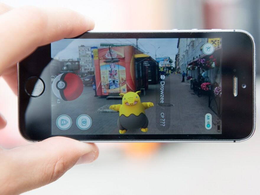 The Pokémon Go location-based mobile game running on a smartphone in Russia.