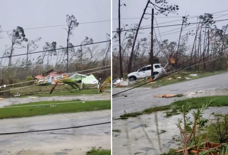 Uprooted trees, fallen power lines and the debris from damaged houses scatter on a road as Hurricane Dorian sweeps through Marsh Harbour, Bahamas.