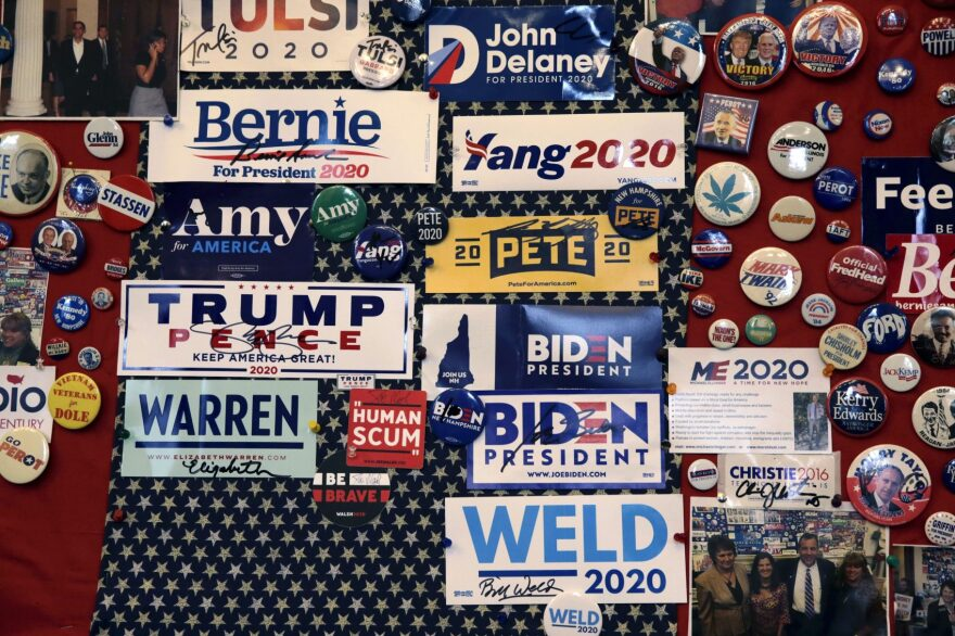 Pins and bumper stickers of presidential contenders in the New Hampshire primary are displayed in the State House visitors center on Nov. 14 in Concord, N.H. (Charles Krupa/AP)