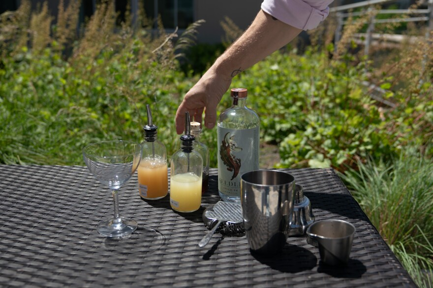 Derek Brown begins making an alcohol-free cocktail.