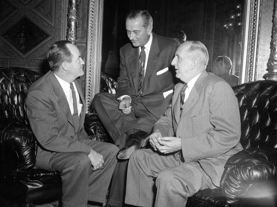 Sen. Lyndon B. Johnson (center) confers with Sens. Hubert H. Humphrey (left) and Sen. Richard B. Russell in 1954. Johnson was elevated to majority leader in 1955 and rapidly grew into the job.