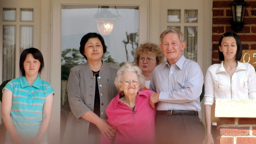Charles Robert Jenkins smiles as he stands with his mother, Pattie Casper (front center) and his wife, Hitomi Soga, (second from left) on June 14, 2005, on his sister's front porch in Weldon, N.C.