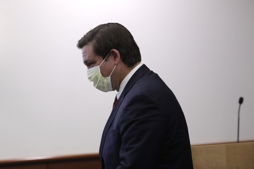 Florida Gov. Ron DeSantis wears a protective mask as he arrives for a news conference at the Cleveland Clinic Florida during the new coronavirus pandemic, Saturday, April 25, 2020, in Weston, Fla.