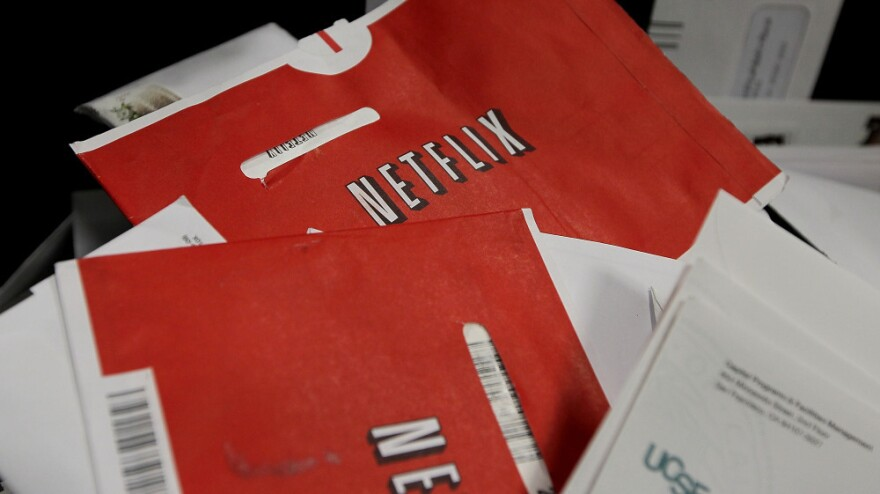 """Say goodbye to the red Netflix envelope, which the company is phasing out in favor of a new DVD delivery service called """"Qwikster."""""""