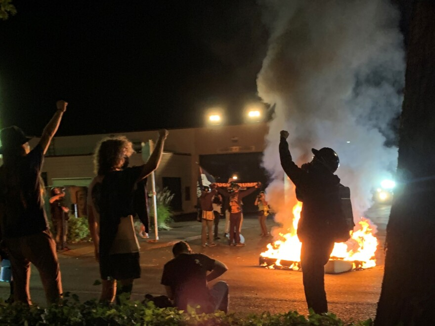 Portland protesters set fire to two mattresses across the street from the Portland Police Bureau's north precinct on Sunday night.