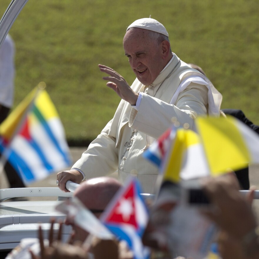 Pope Francis waves from his popemobile as he arrives for Mass at the Plaza of the Revolution in Holguin, Cuba, Monday.