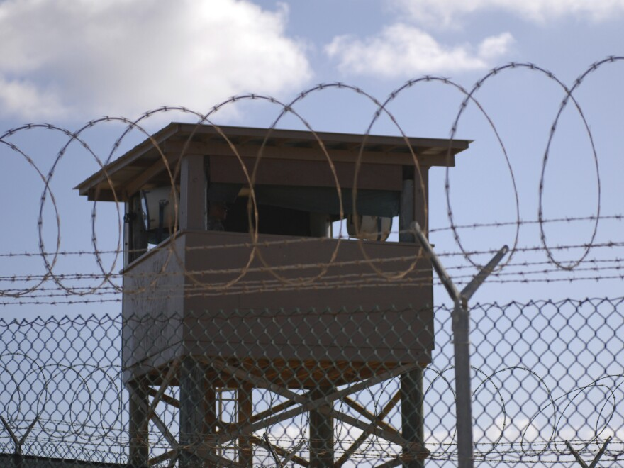 A tower overlooking Camp Delta at the Guantánamo Bay naval base in 2009. The judge overseeing the proceedings there has announced his retirement just nine months after taking the job.