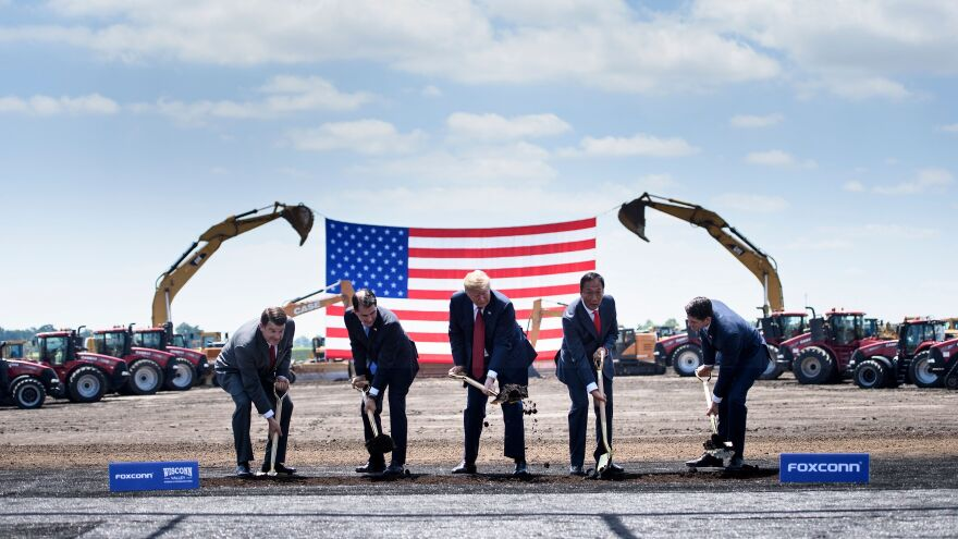 "President Trump participates in a groundbreaking for the Foxconn campus in Mount Pleasant, Wis., in June 2018. With him are Christopher ""Tank"" Murdock (from left), the first Wisconsin Foxconn employee; former Gov. Scott Walker, Foxconn Chairman Terry Gou and former Speaker of the House Paul Ryan."