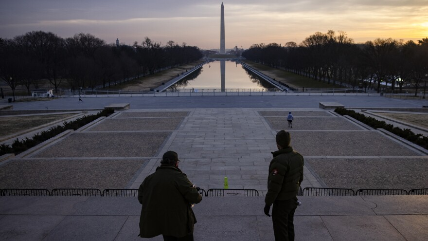 "U.S. park rangers look at the spot where Rev. Martin Luther King Jr. gave his famous ""I Have a Dream"" speech on the steps of the Lincoln Memorial in Washington, D.C., on Friday. Security threats have prompted officials to shut down the National Mall and much of downtown Washington, D.C."