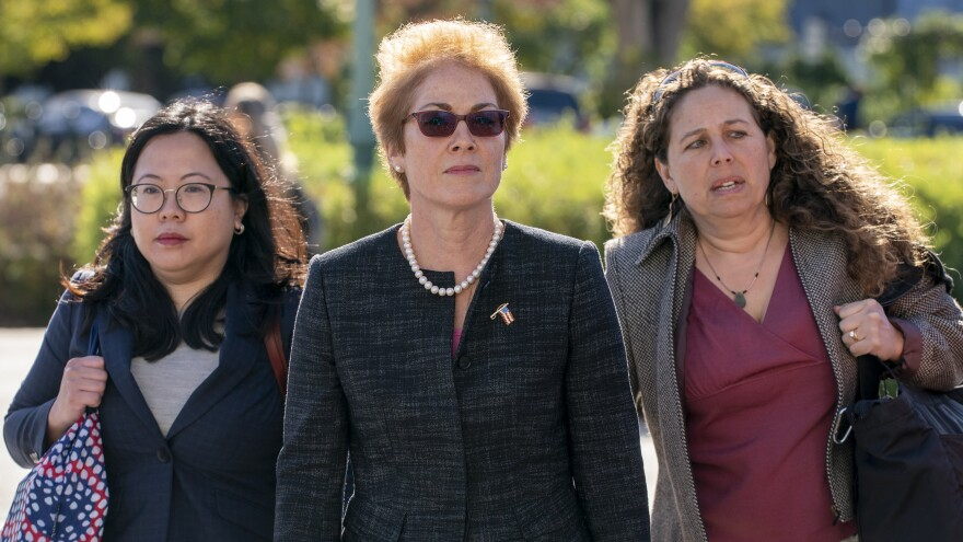 Former U.S. ambassador to Ukraine Marie Yovanovitch (center) arrives on Capitol Hill Friday for congressional testimony.