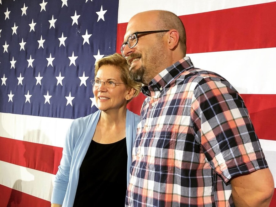 "Jeromy Brown, 46, poses for a photo with Sen. Elizabeth Warren. Brown, like many progressive voters, thinks 2020 presidential candidates should ""not equivocate"" in calling Trump a white supremacist."