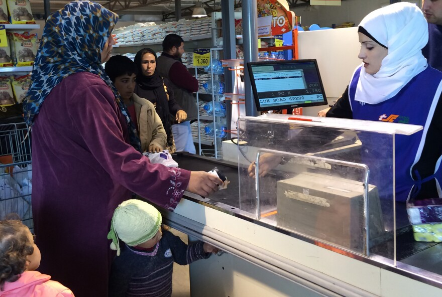 The Sultan Center Safeway is staffed by Syrian refugees who had to learn new skills to work here.